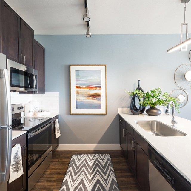 Cypress at Trinity Groves - Chef-Inspired Modern Kitchen with Stainless Steel Appliances